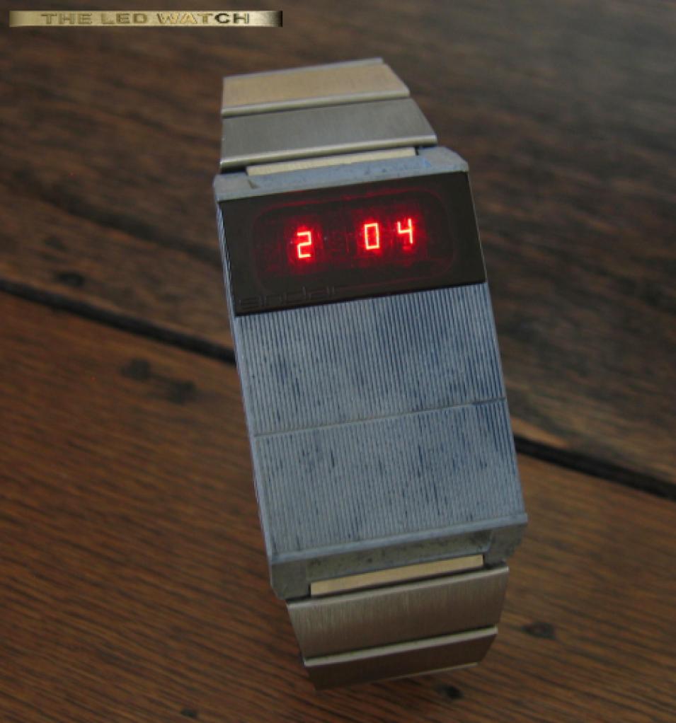 Grey Sinclair LED watch.